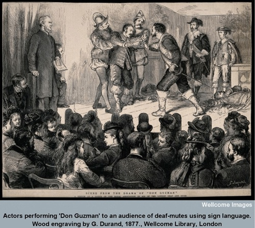 Actors performing 'Don Guzman' to an audience of deaf-mutes using sign language. Wood engraving by G. Durand, 1877.