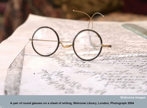 A pair of round glasses on a sheet of writing, Wellcome Library, London, Photograph 2004