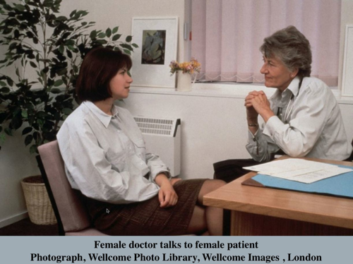 Female doctor talks to female patient