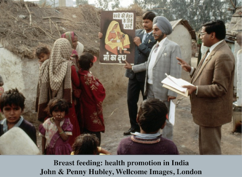 John & Penny Hubley, Wellcome Images, London Breast feeding: health promotion . In this urban slum in India, a poster on mother and child health and breast feeding is being tested. Ideally, health education programms should start with trials in small groups before wider implementation.  Second half 20th century